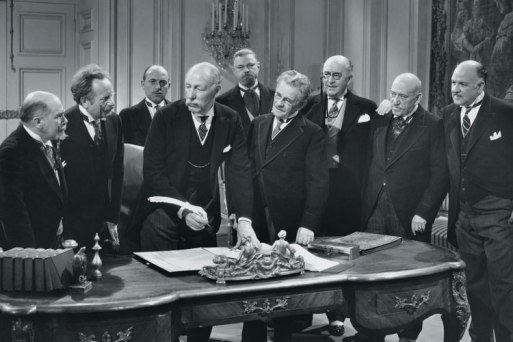 group-of-old-men-signing-paperwork